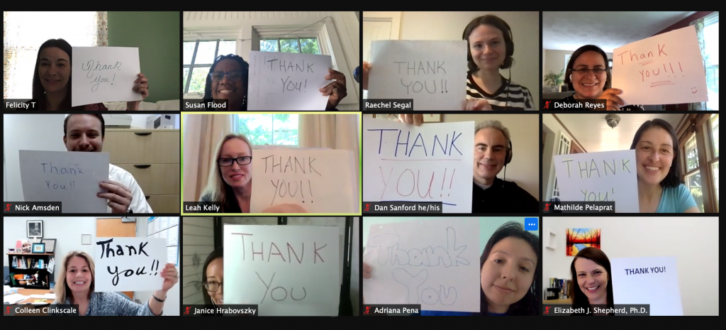 ACS Staff holding thank you sign
